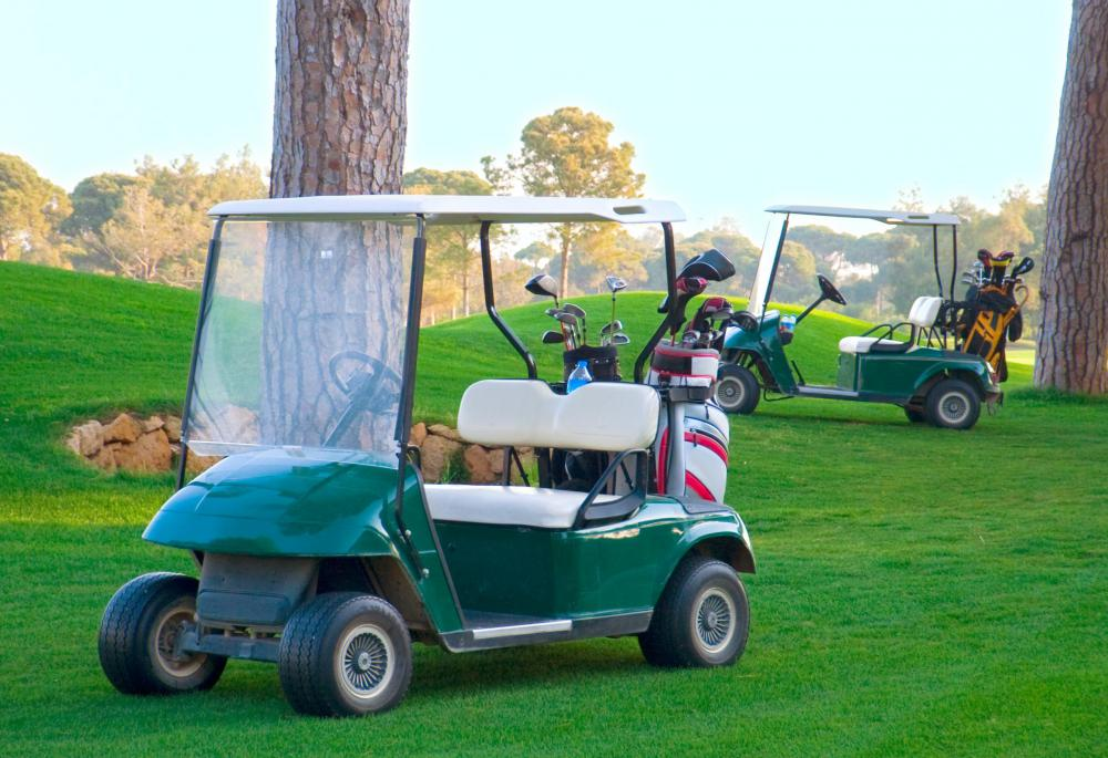 Using a golf cart to get from hole to hole can take away some of the strain of golfing.