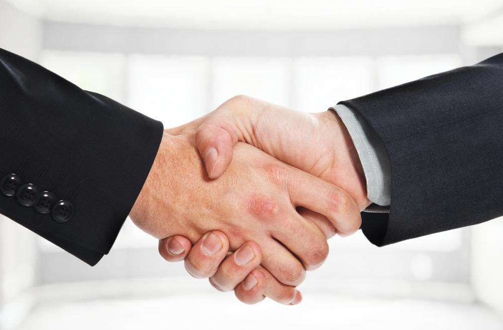 Effective business communication may include use of a handshake.