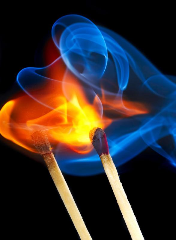 The color of a flame depends on its temperature and the materials being burned.
