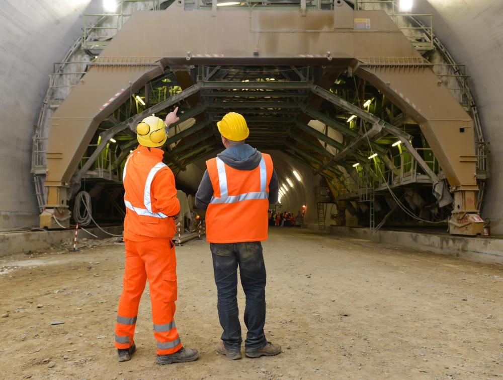 The beams used in a tunnel design must be strong enough to support thousands of tons of concrete and dirt.