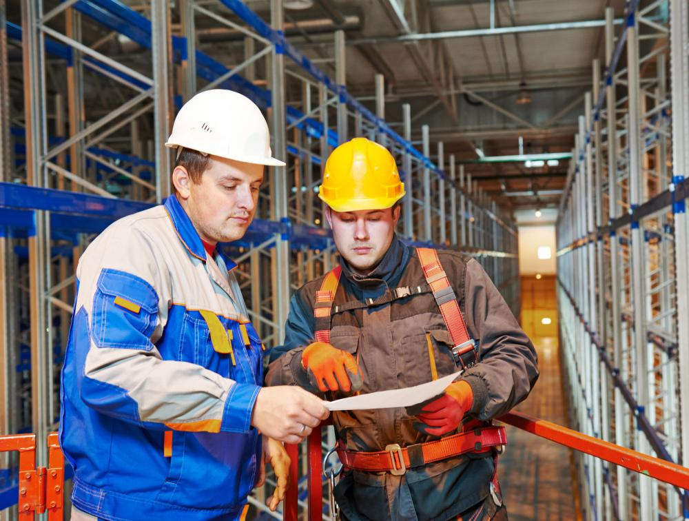 A structural engineer may work closely with construction project managers during the design and building of a manufacturing plant.
