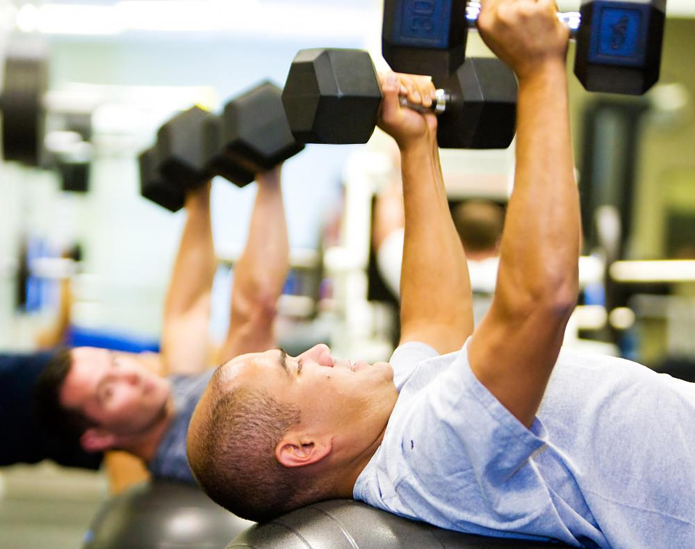 Chest presses performed on exercise balls can be used to strengthen the pectoral muscles.