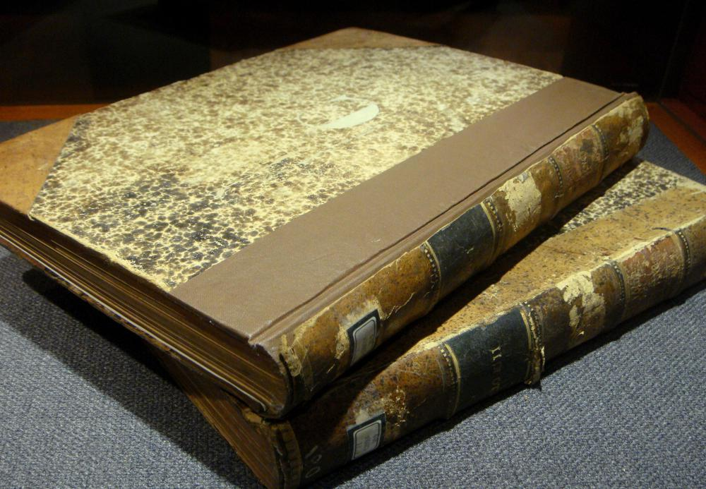 Older books were sewn together, while modern books are often glued.