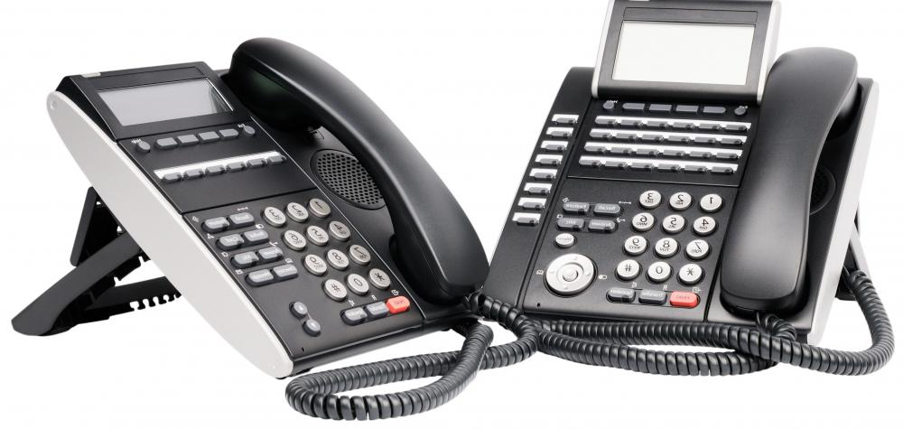 Network support specialists may work on telephones to set up teleconferencing options.