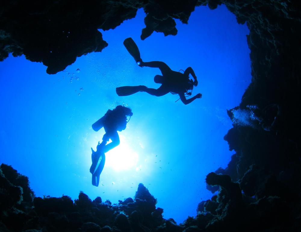 Extreme activities for travel may include cave diving.