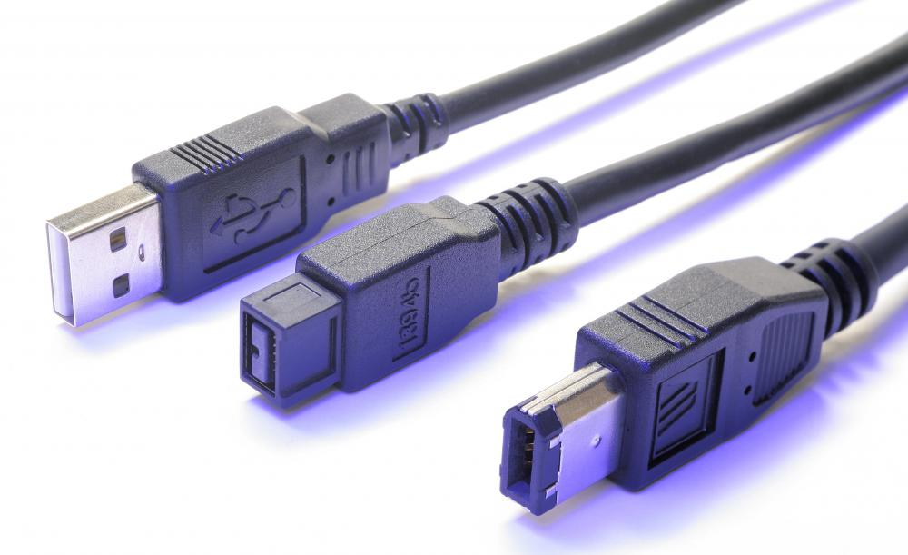 A USB cable to the left of two Firewire® cables.