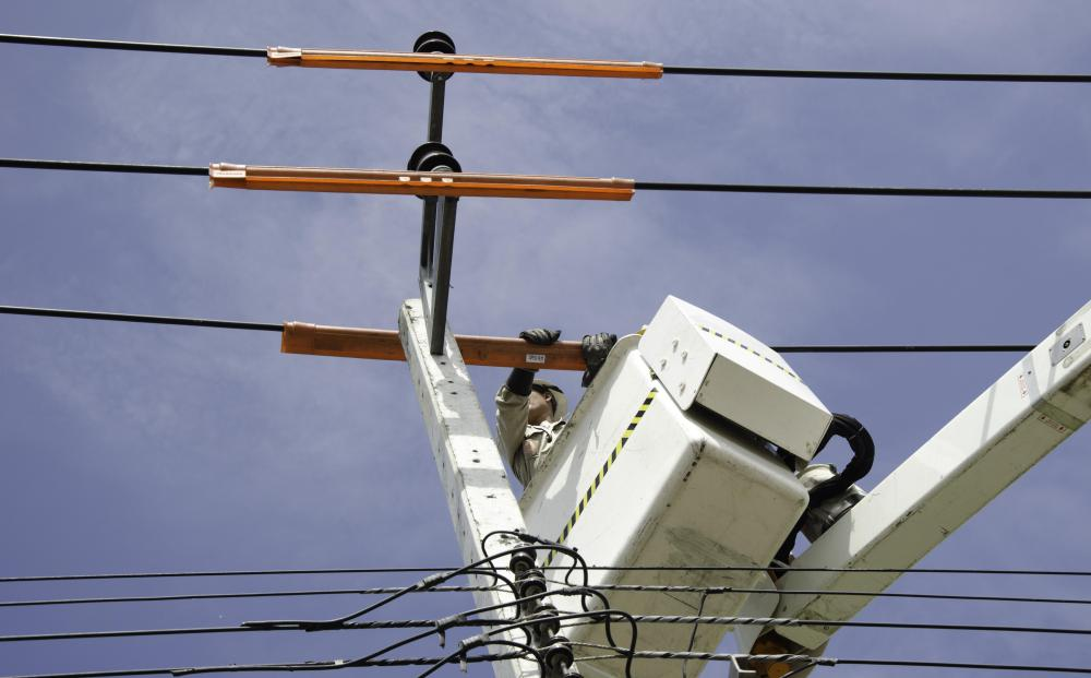 Line crews may use bucket trucks to trim limbs near power or telephone lines.