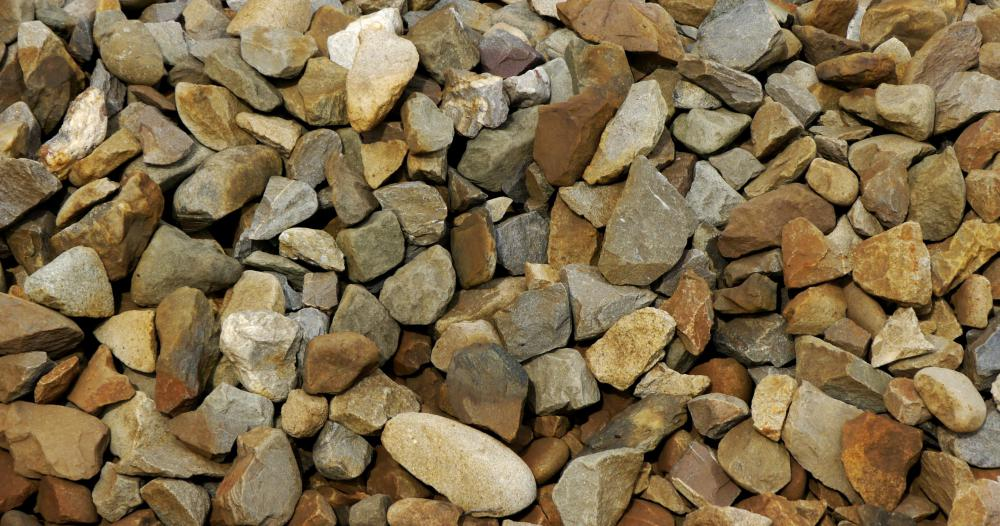 To achieve the best results at a construction site, test various sizes of rock aggregate before choosing any one material to lay down.