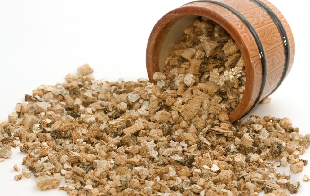 Vermiculite usually looks  like tiny pebbles that may be golden-brown in color.
