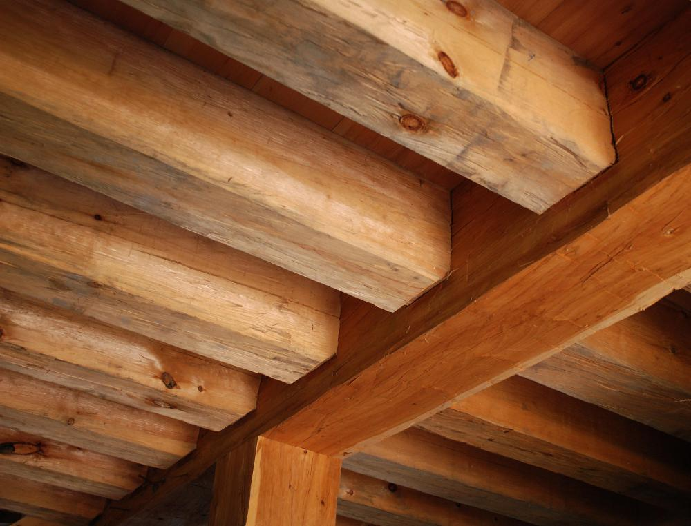 View of second story wooden floor joists from below.