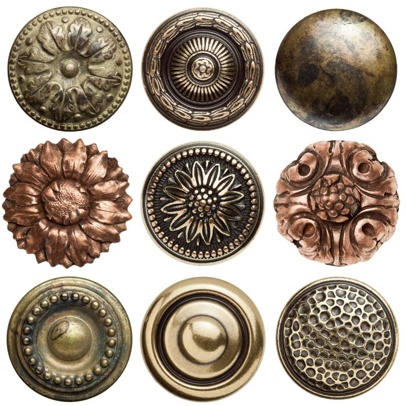 A collection of vintage metal buttons.