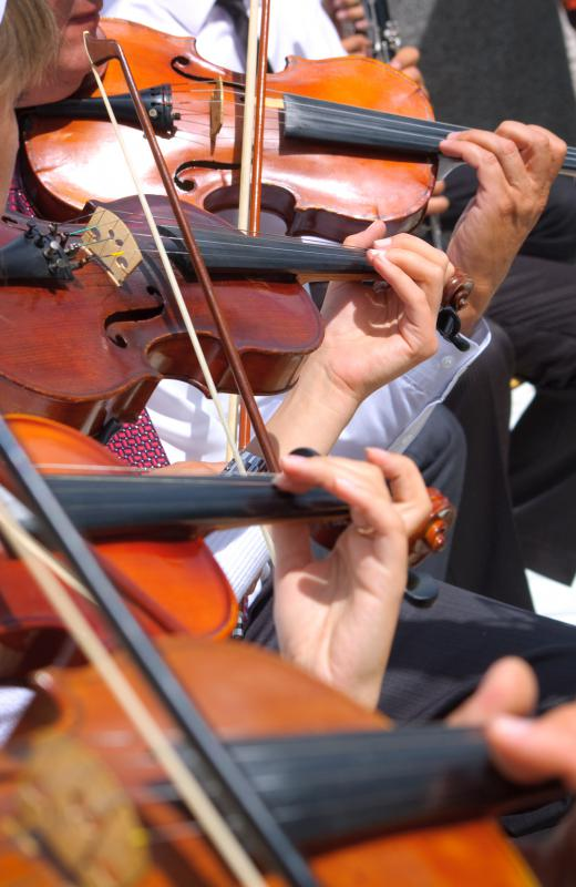 A full orchestra features a variety of instruments, such as violins.