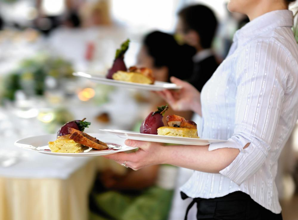 A waitress must be able to carry heavy plates without dropping them.