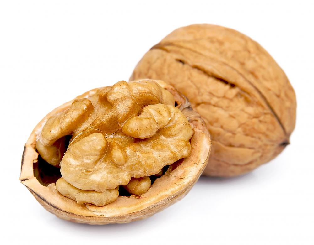 A child can use walnuts to make a three dimensional illustration as part of a Thanksgiving craft project.