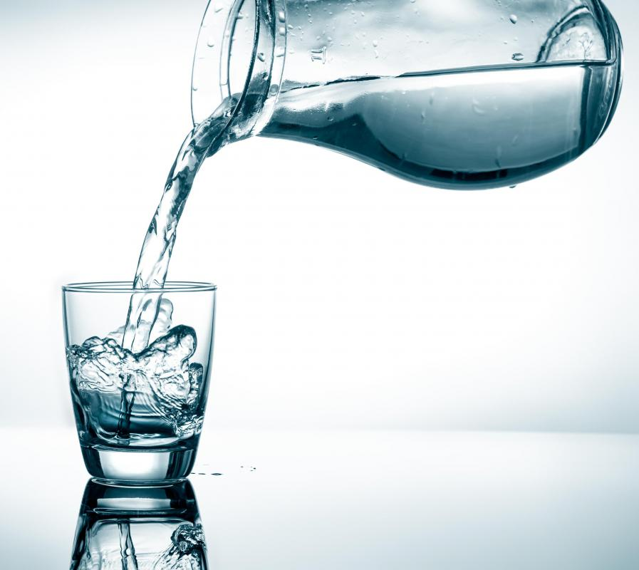 It is important to drink eight glasses of water per day during a weight loss plateau.