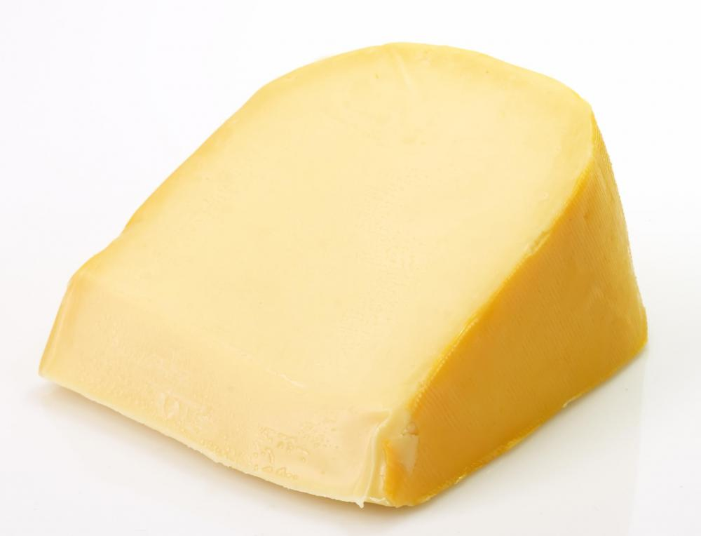 Wedge of aged Gouda cheese.