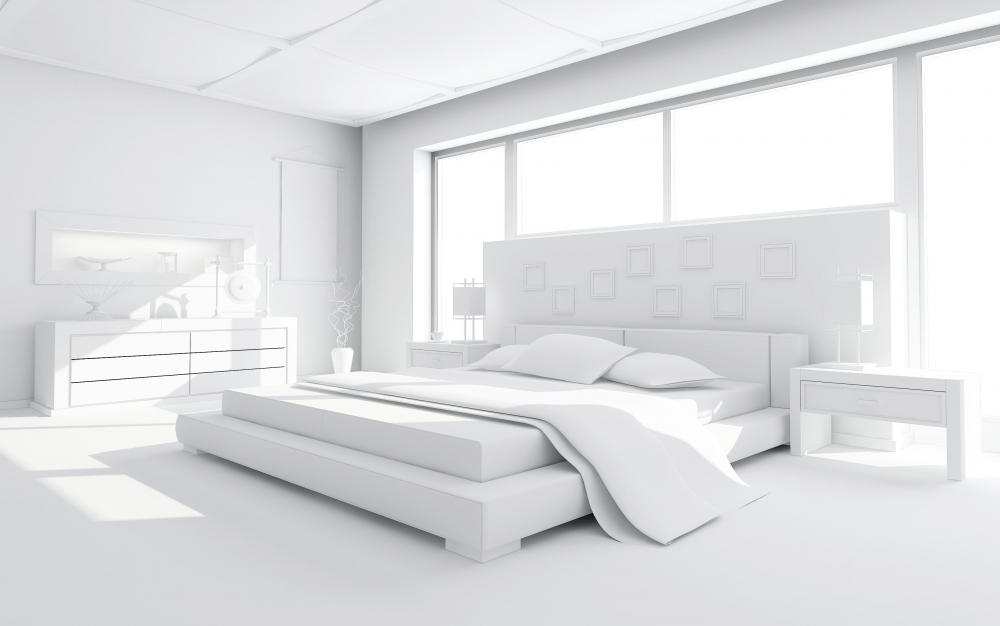 White bedroom with an eastern king (standard king) size bed.