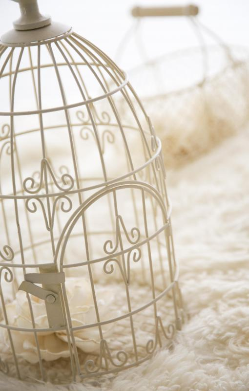 An ornamental birdcage fits the shabby chic style.