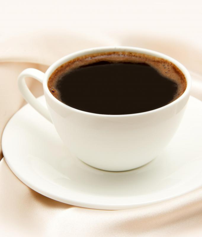 A cup of coffee may help to balance out the sweetness of a fasnacht.