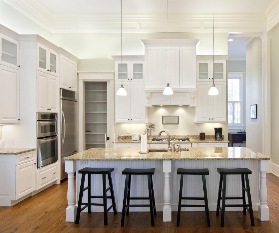 Hanging lights are popular in modern kitchens.