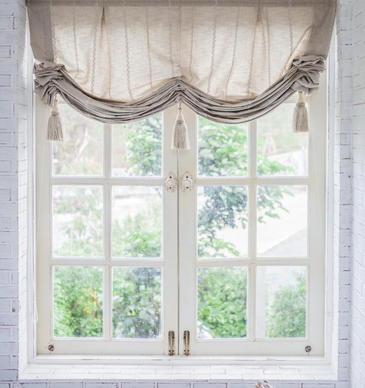 Window treatments complement French doors.