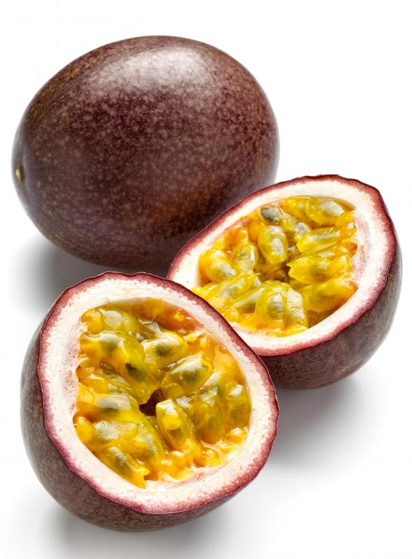 Whole and cut passion fruit, the fruit of a passion flower.
