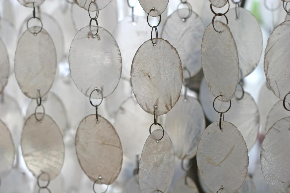Suncatchers may be incorporated into wind chimes for a visual as well as auditory affect.