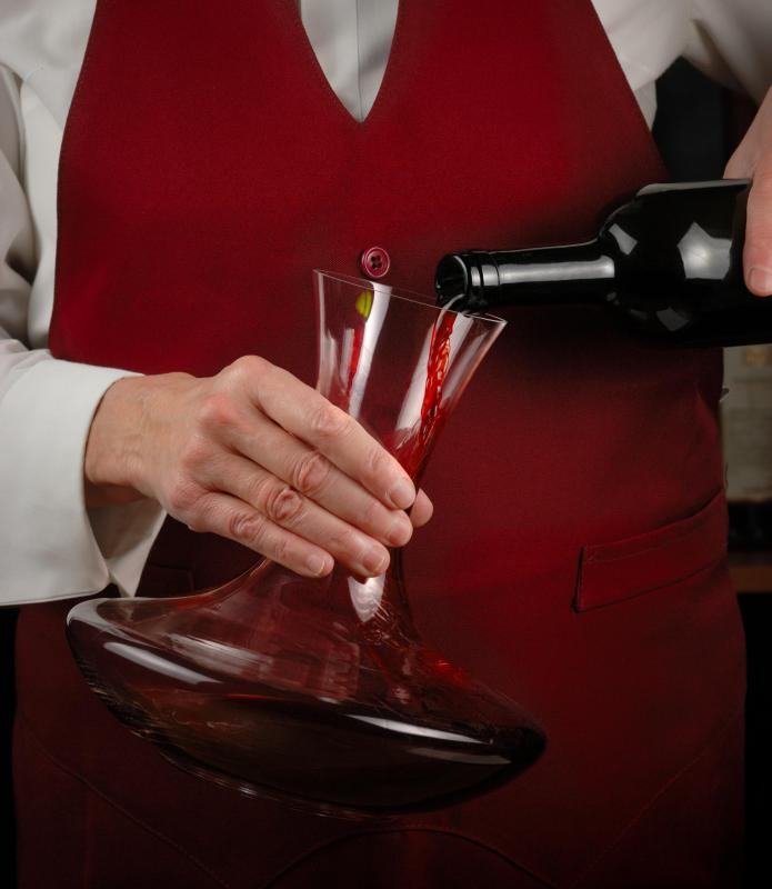 Wine is poured into a decanter to allow the beverage to breathe.