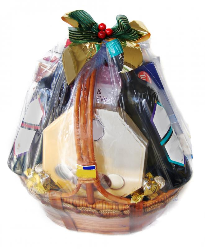 A gift basket with wired ribbon on top.