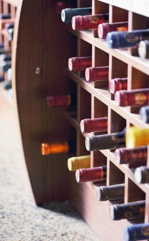 When storing wine on a wine rack, sparkling wine should sit at the bottom, with white wine above that, and red wine above the white.