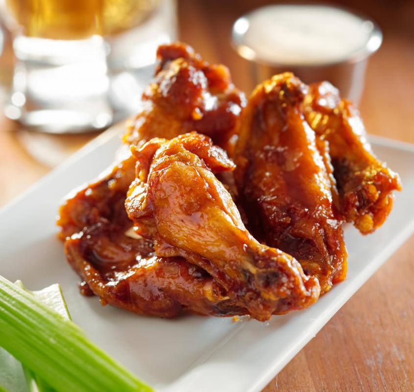 Chicken wings may be broiled to make a healthier appetizer.