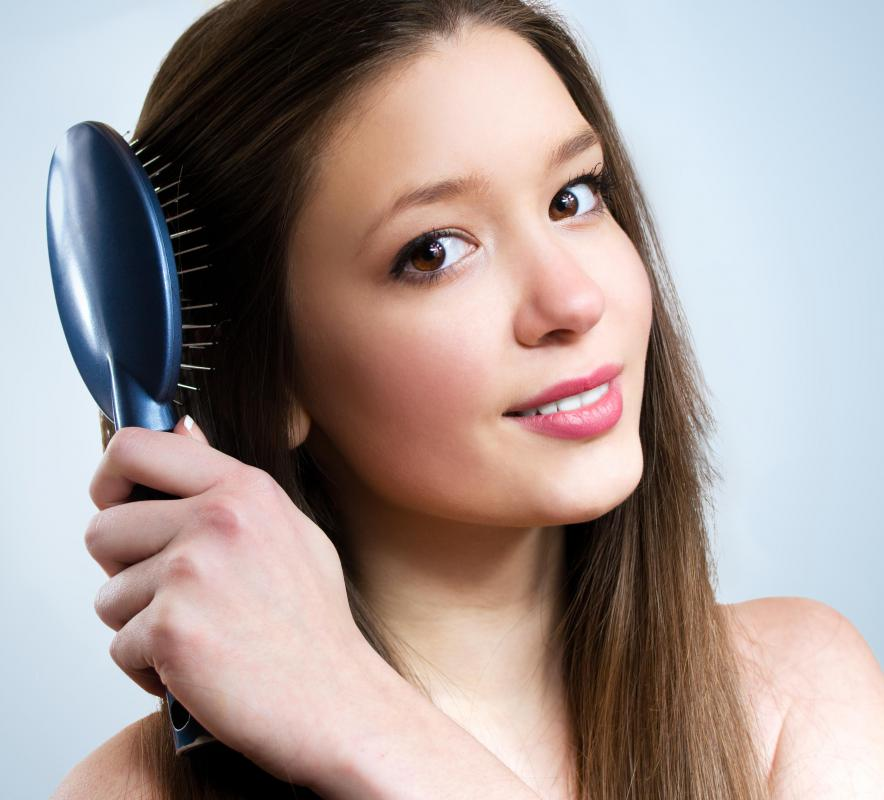 Regular hair brushing is a simple part of personal care.
