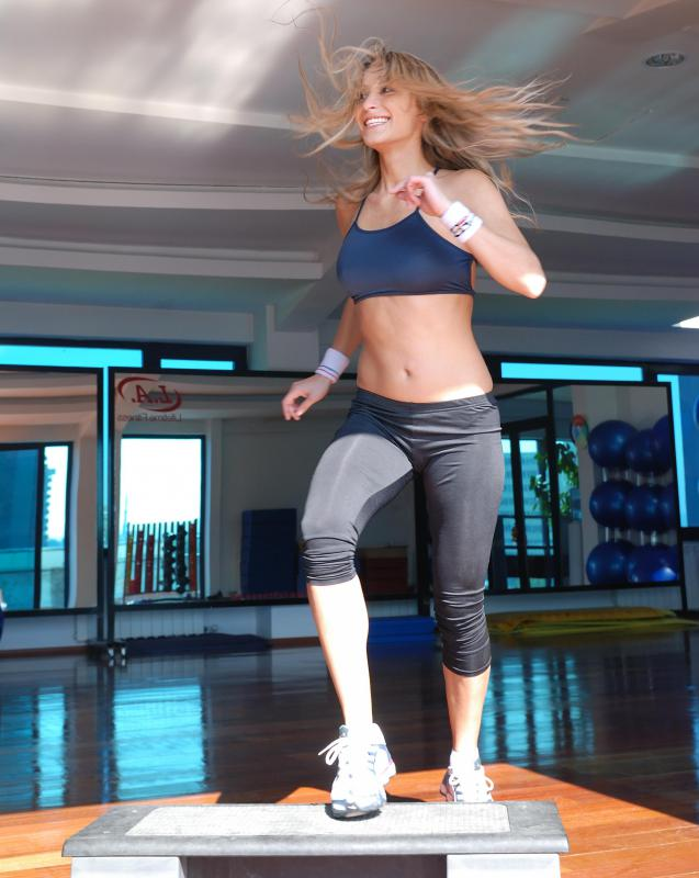 Listening to music while doing step aerobics can help establish a rhythm for the workout routine.