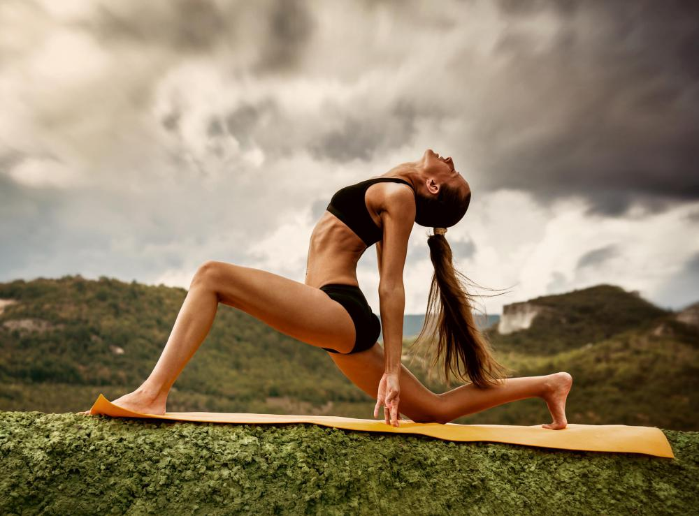 Yoga is a low-impact workout that strengthens muscles.