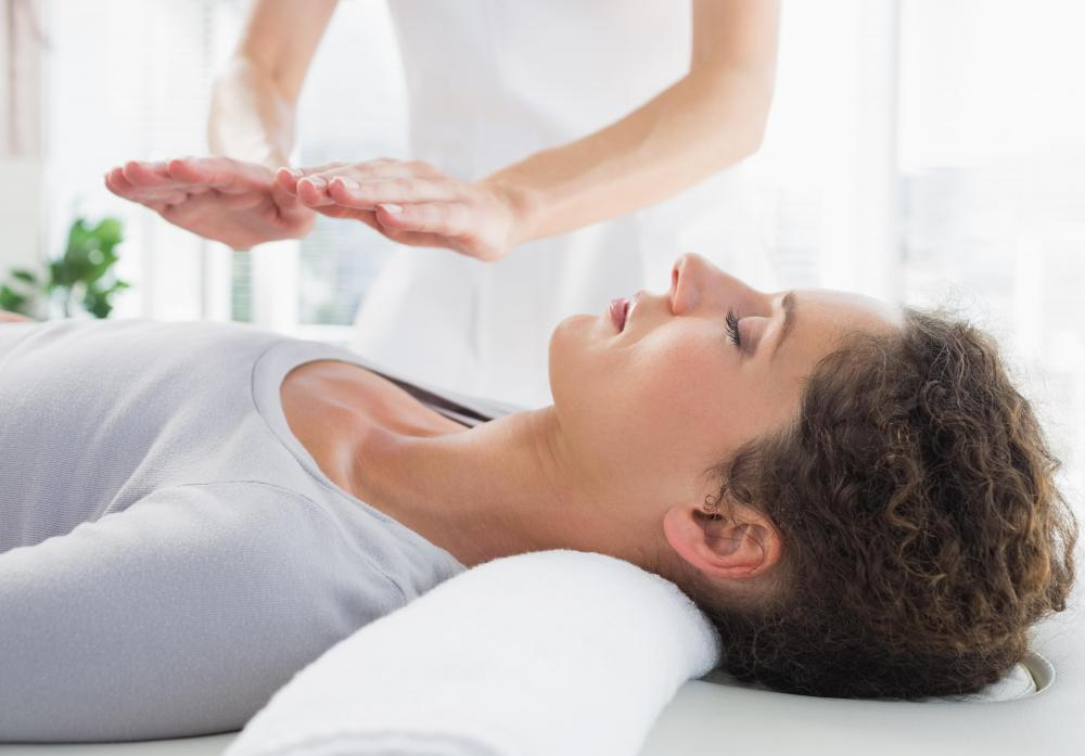 Reiki therapy involves visualizing the energy field around the body and working within this field without actually touching the client.