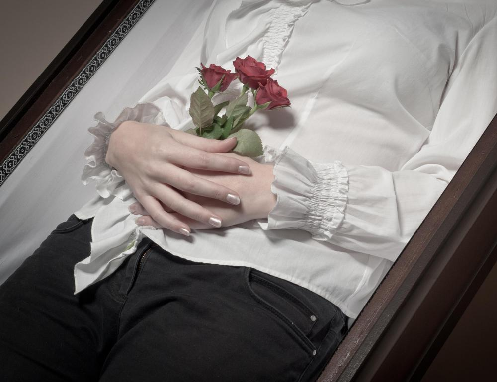A mortician may help prepare a body for burial.