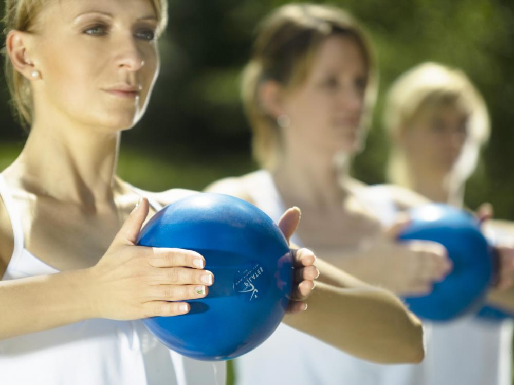 Some pilates workouts may utilize light weights, many of which are ball or ring-shaped.