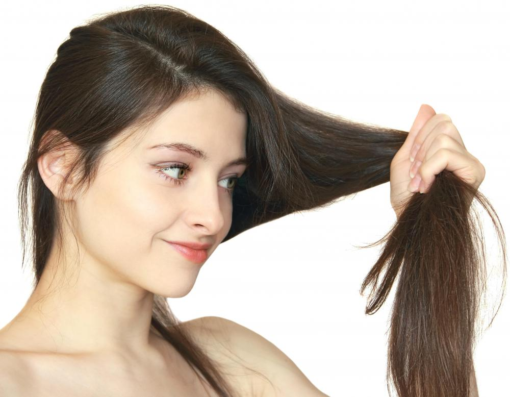Castor oil helps seal moisture into individual strands of hair.
