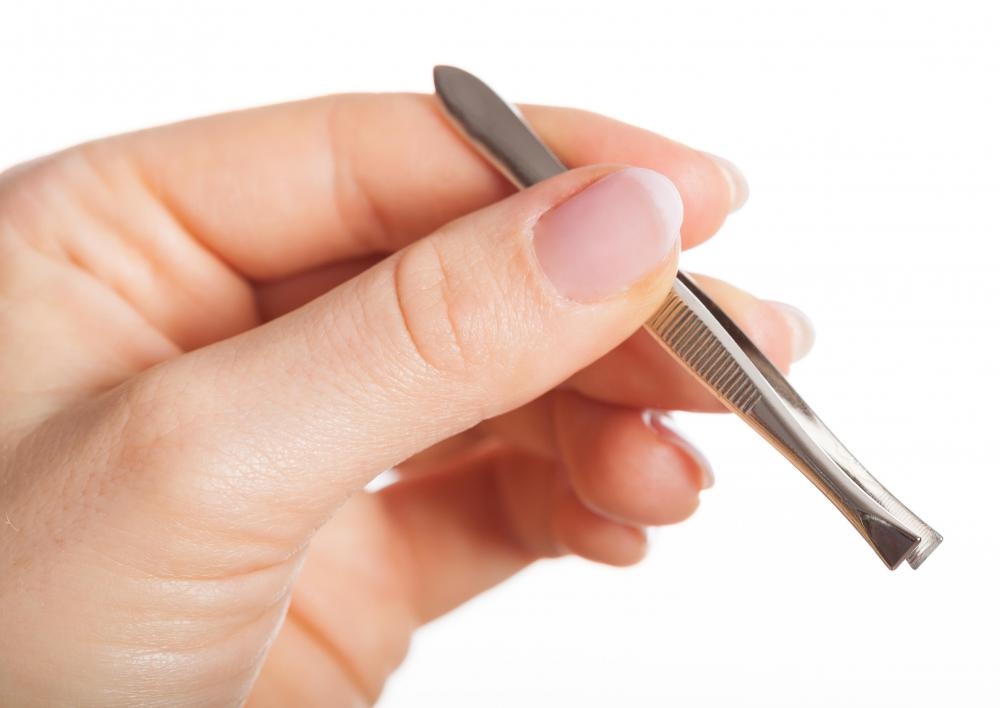 Tweezers can be used to make adjustments to the placement of the false eyelashes.