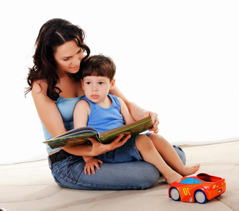 Nannies provide direct care to children, including activities such as reading.