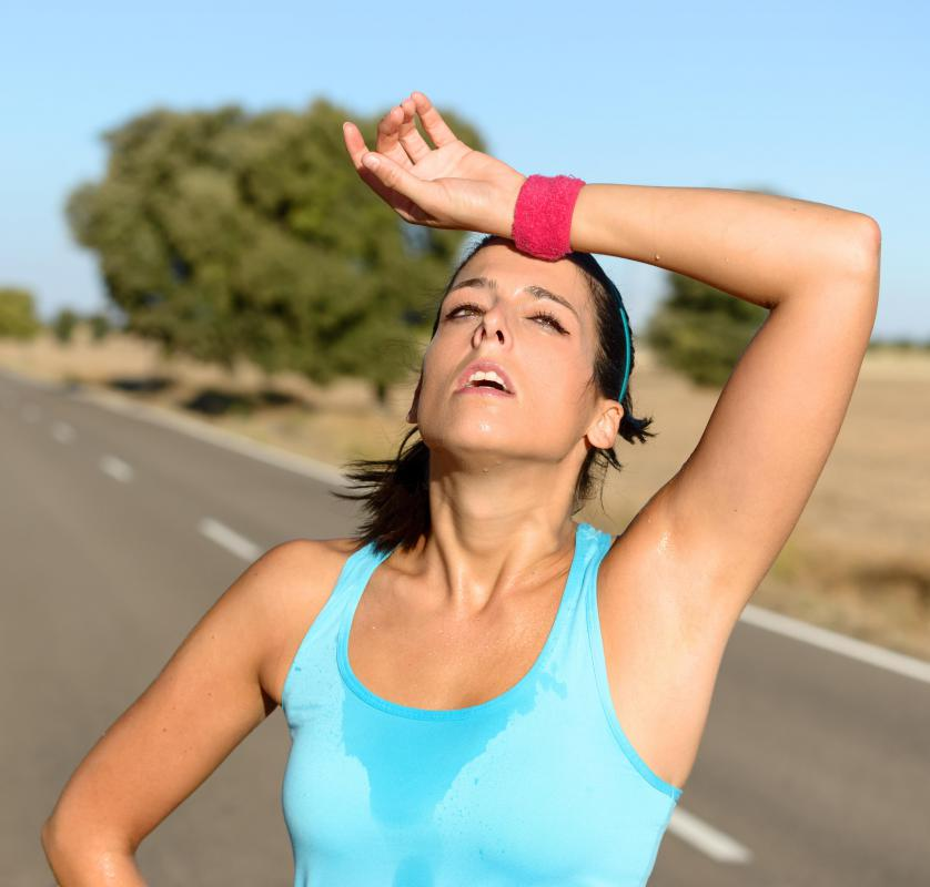 People start to sweat when they exercise because of exercise-induced thermogenesis.