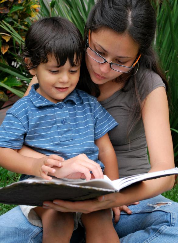 Parents reading to their children is often the first step in developing literacy.
