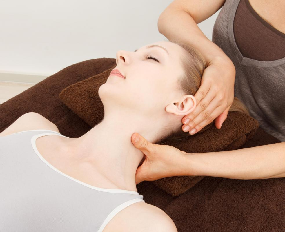 The second reiki hand position can help to relieve tension in the neck.