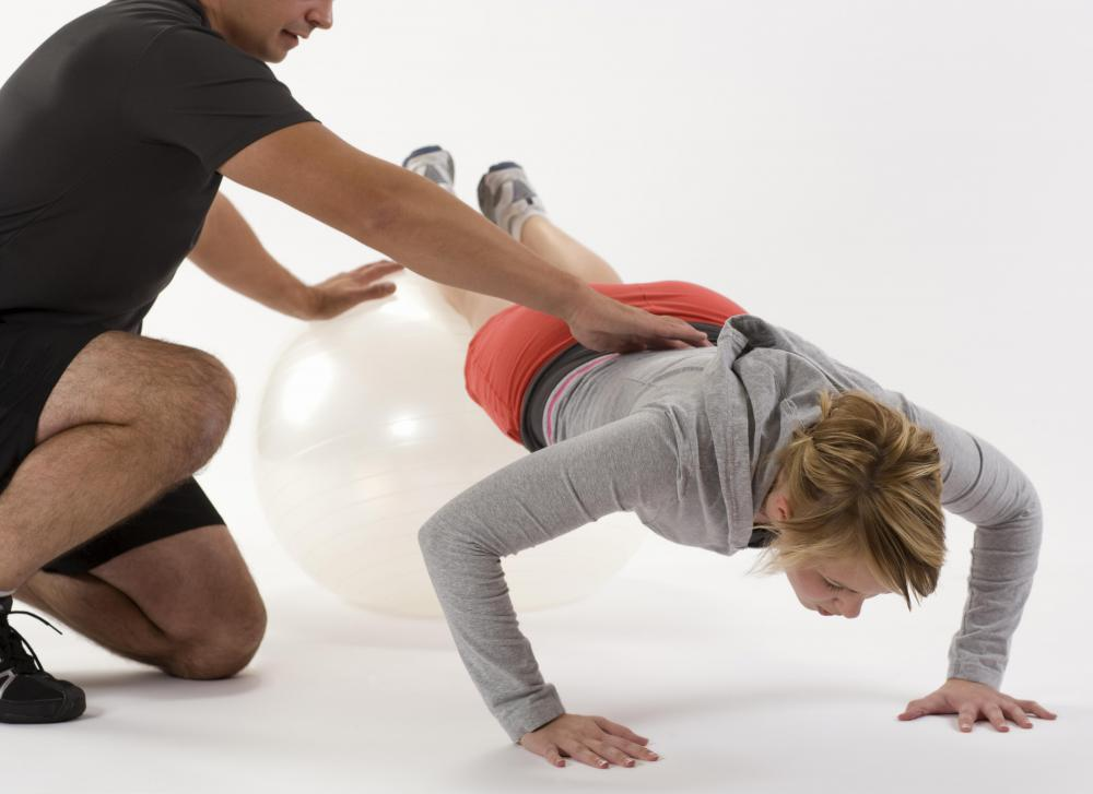 It may be helpful to enlist the help of a personal trainer when performing core exercises.