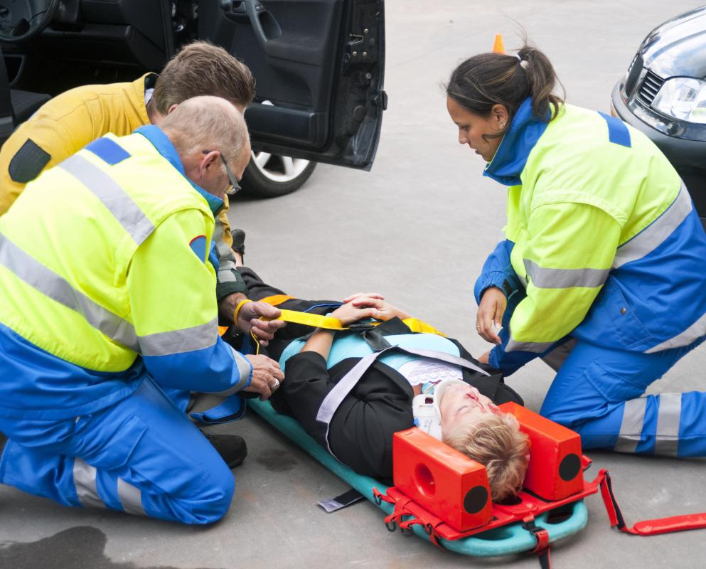EMTs must perform trauma assessment on arrival and determine how to stabilize the patient for transport.