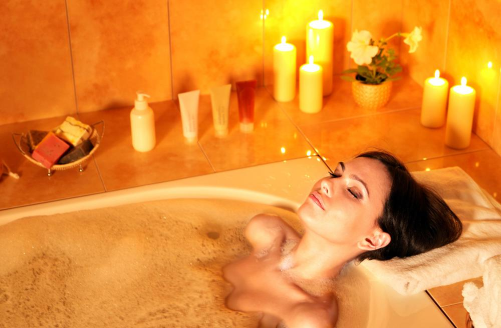Relaxing in a hot bath can help alleviate pain from whiplash.