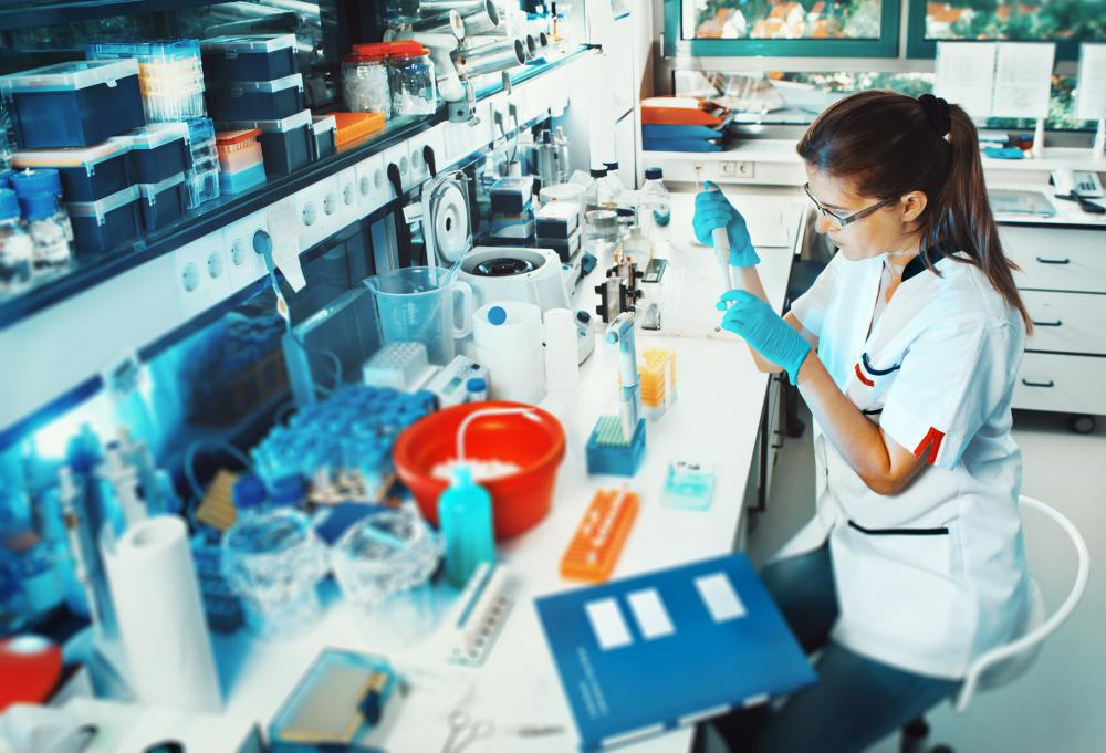 Medical technicians analyze biological samples from patients in a laboratory.