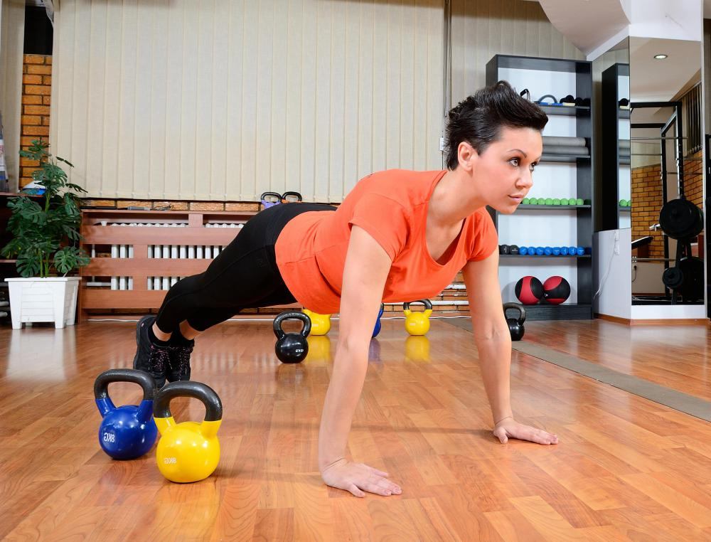 Push-ups, which require no equipment to perform, can strengthen and tone the chest, arms and shoulders.
