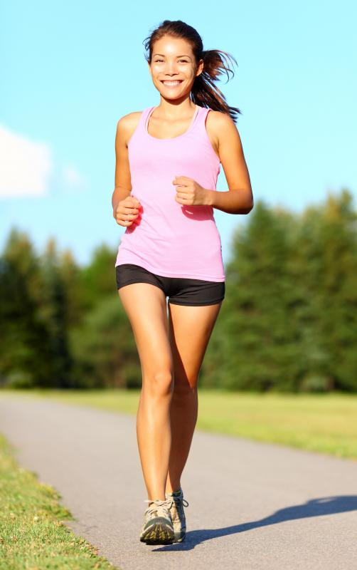 Exercise that causes perspiration, such as jogging, will aid in the removal of a a henna tattoo.