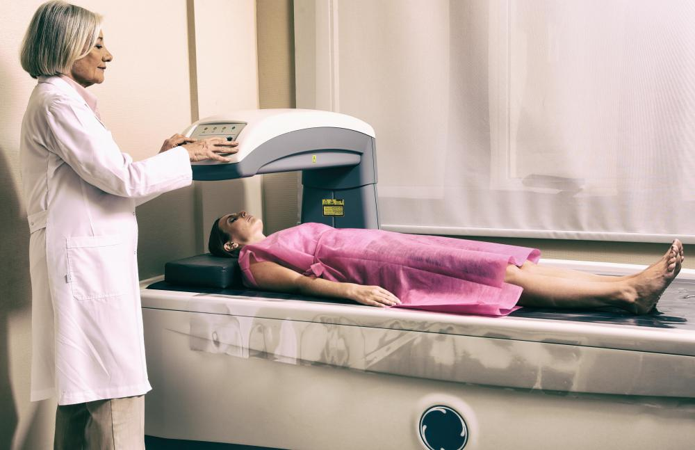A bone densitometry scan measures bone mineral density to evaluate bone density loss.